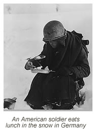 American soldier eats lunch in the snow in Germany.